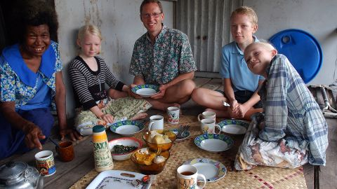 The family -- seen taking in a home-cooked meal in Papua New Guinea -- has enjoyed experiencing other cultures through their cuisines and learning recipes.