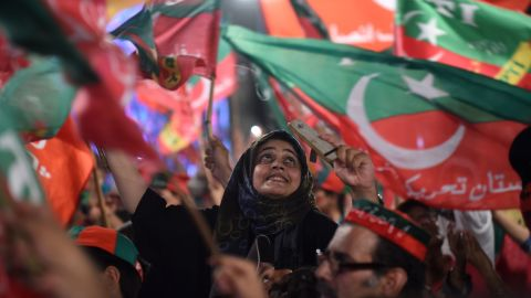 Supporters of Imran Khan cheer at a rally in Lahore on July 23, 2018.