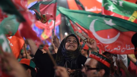 Supporters of Pakistani cricket star-turned-politician and head of the Pakistan Tehreek-e-Insaf (PTI) Imran Khan, cheer and wave flags during a rally during the last campaign day, in Lahore, on July 23, 2018.