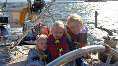 With life jackets firmly secured, the Gifford siblings sailed through San Francisco at the start of their journey: four-year-old Siobhan (left), six-year-old Mairen (middle) and nine-year-old Niall (right) could not swim at the time, though they would soon take to the water like fish.