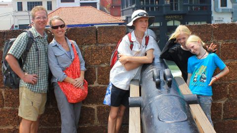 The family poses in the state of Malacca in Malaysia in 2014. Niall (center with hat) recently moved on from life at sea to pursue his university degree in Portland, Oregon.