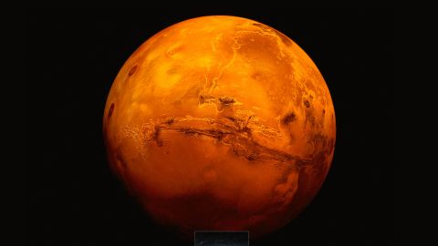Artistic impression of the Mars Express spacecraft probing the southern hemisphere of Mars.