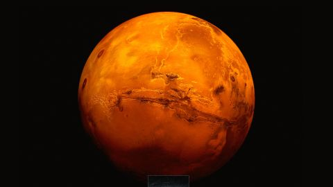 An artistic impression of the Mars Express spacecraft probing the southern hemisphere of Mars. Radar detected a lake of liquid water beneath the surface.