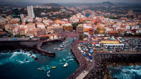 """<strong>Puerto de la Cruz, Tenerife, Spain</strong>: This drone image shows the Virgen del Carmen festival that honors the patron saint of fishermen on the Spanish island of <a href=""""https://edition.cnn.com/travel/article/spain-island-tenerife/index.html"""">Tenerife</a>. Local residents take a statue of the Virgen del Carmen on board an adorned boat and sail it along the coast."""