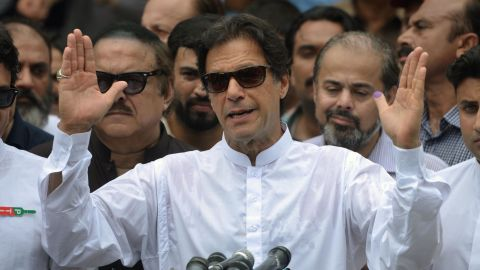 Pakistan's cricketer-turned politician Imran Khan of the Pakistan Tehreek-e-Insaf (Movement for Justice) speaks to the media after casting his vote at a polling station during the general election in Islamabad on July 25, 2018. - Pakistanis voted July 25 in elections that could propel former World Cup cricketer Imran Khan to power, as security fears intensified with a voting-day blast that killed at least 30 after a campaign marred by claims of military interference. (Photo by AAMIR QURESHI / AFP)        (Photo credit should read AAMIR QURESHI/AFP/Getty Images)