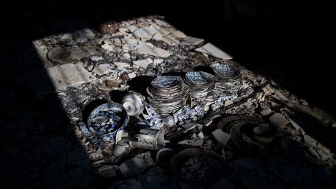 Dinnerware destroyed by the fire is seen inside a house in the village of Neos Voutzas on July 25.
