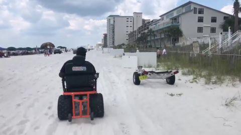Thomas at Panama City Beach in the beach wheelchair.