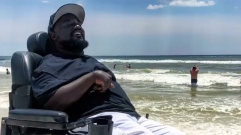 David Thomas, 36, visits the beach for the first time. This trip was his second time leaving his home county of Jefferson County, Alabama. He used a special motorized beach wheelchair to have a beach day in Panama City Beach, Florida.