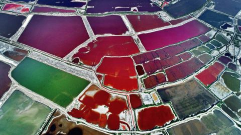 <strong>Yungcheng City, China:</strong> An abstract-looking, multicolored Salt Lake is spotted over Yuncheng in China's<strong> </strong>Shanxi Province, west of Beijing. The lake changes color as water density fluctuates.