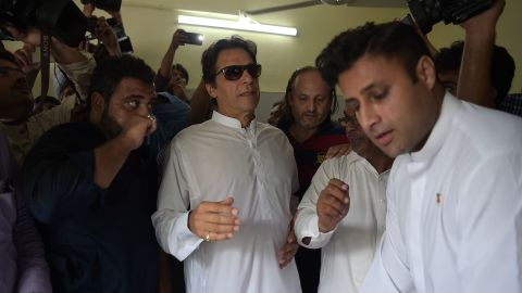 Cricket star-turned-politician Imran Khan arrives at an Islamabad polling station to vote Wednesday.