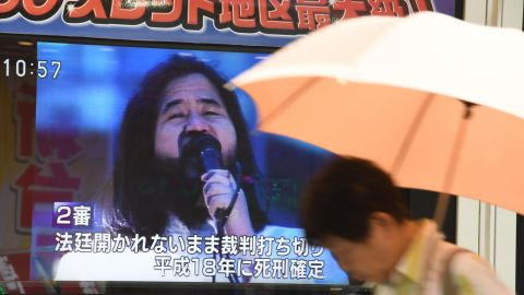 A pedestrian walks past a screen flashing news on the execution of Shoko Asahara, the leader of the Aum Shinrikyo cult, in Tokyo on July 6, 2018. - Shoko Asahara, the leader of the Aum Shinrikyo cult that carried out a deadly sarin attack on Tokyo's subway in 1995, was executed on July 6, two decades after the group's shocking crime. (Photo by Toshifumi KITAMURA / AFP)        (Photo credit should read TOSHIFUMI KITAMURA/AFP/Getty Images)