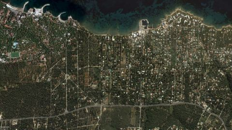 A satellite image of Mati taken in October last year shows how many houses were surrounded by flammable forest.