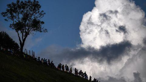 Spectators gather on a slope on July 25.