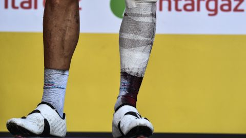 Belgium's Philippe Gilbert stands on the podium after the 16th stage on Tuesday, July 24. He injured his leg in a crash and had to bow out of the Tour.