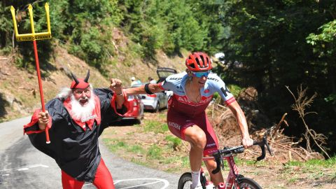 Germany's Nils Politt passes an exuberant fan during the 11th stage on July 18.