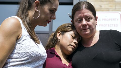 Yeni Gonzalez, a Guatemalan mother who was separated from her three children at the U.S.-Mexico border, center, is embraced by volunteer Janey Pearl, left, and Julie Schwietert Collazo during a news conference Tuesday, July 3, 2108 in New York. Gonzalez saw her children in a New York City facility for the first time since mid May.  She was driven cross-country by a team of volunteers after she was released from Eloy Detention Center in Arizona on Thursday. (AP Photo/Craig Ruttle)