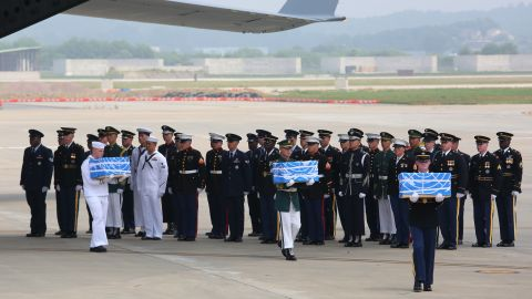 PYEONGTAEK, SOUTH KOREA - JULY 27: U.N. honor guards carry small boxes containing remains believed to be from American servicemen killed during the 1950-53 Korean War after arrived from North Korea, at Osan Air Base on July 27, 2018 in Pyeongtaek, South Korea. (Photo by Ahn Young-joon - Pool/Getty Images)