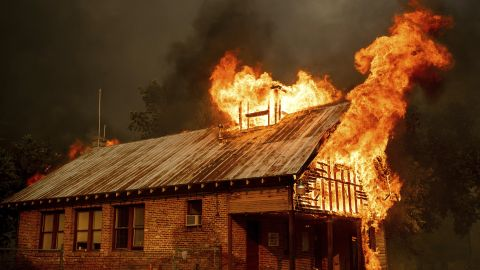 An historic schoolhouse burns as the Carr Fire tears through Shasta, Calif., Thursday, July 26, 2018. Fueled by high temperatures, wind and low humidity, the blaze destroyed multiple homes and at least one historic building. (AP Photo/Noah Berger)