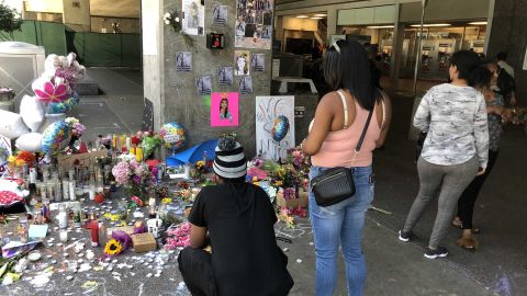 Oakland residents  visit a memorial to Nia Wilson at the BART station where she was killed.