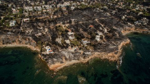 """An aerial photo, taken on Thursday, July 26, shows damage that a wildfire caused in the Greek village of Mati. Authorities investigating the wildfire said that there are """"serious indications of arson,"""" but extreme weather conditions -- high temperatures, strong westerly winds and a dry winter -- contributed to the disaster."""