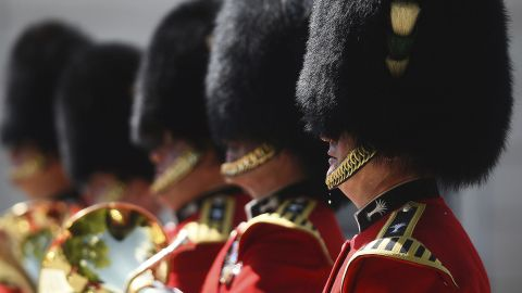 """A bead of sweat falls from a member of the Queen's Guard as he takes part in a changing of the guard ceremony in London on Monday, July 23. The UK is currently in the midst of <a href=""""https://www.cnn.com/2018/07/26/uk/uk-heat-wave-intl/index.html"""" target=""""_blank"""">one of its hottest summers on record,</a> according to the Met Office."""