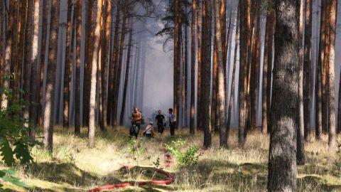 Firefighters tackle a forest fire near Potsdam, Germany, on Thursday, July 26.