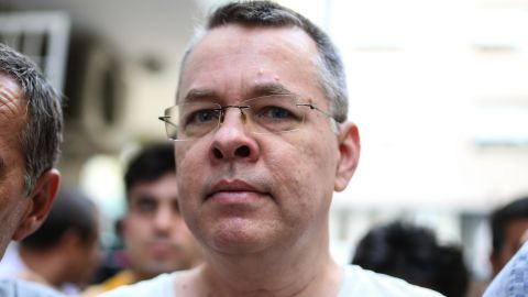 US pastor Andrew Craig Brunson escorted by Turkish plain clothes police officers arrives at his house on July 25, 2018 in Izmir. - Turkey on July 15, 2018 moved from jail to house arrest US pastor Andrew Brunson who has spent almost two years imprisoned on terror-related charges, in a controversial case that has ratcheted up tensions with the United States. Andrew Brunson, who ran a protestant church in the Aegean city of Izmir, was first detained in October 2016 and had remained in prison in Turkey ever since. (Photo by - / AFP)        (Photo credit should read -/AFP/Getty Images)