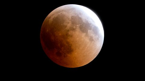 """A blood moon rises over Gaza City, Friday, July 27, 2018. Skywatchers around much of the world are looking forward to a complete lunar eclipse that will be the longest this century. The so-called """"blood moon"""" Friday, when it turns a deep red, will be visible at different times in Australia, Africa, Asia, Europe and South America when the sun, Earth and moon line up perfectly, casting Earth's shadow on the moon. (AP Photo/Hatem Moussa)"""
