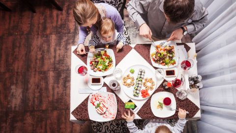 """Parents should model healthy eating behavior, said Ellyn Satter, author of """"Child of Mine: Feeding with Love and Good Sense.""""<br />""""Kids do better with eating when they get their parents' undivided, positive attention,"""" said Satter, adding that rule applies even when serving take-out or going to a restaurant. """"However you put together a meal, it's still important to sit down together and pay attention to each other when you eat it."""""""