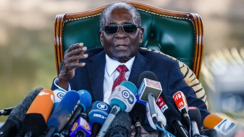 """TOPSHOT - Former Zimbabwean President Robert Mugabe addresses media on July 29, 2018 during a surprise press conference at his residence """"Blue Roof """" in Harare, on the eve of the country's first election since he was ousted from office last year. - Zimbabwe goes to the polls on July 30 in its first election since Mugabe was forced to resign last November after 37 years in power, with allegations mounting of voter fraud and predictions of a disputed result. (Photo by Jekesai NJIKIZANA / AFP)        (Photo credit should read JEKESAI NJIKIZANA/AFP/Getty Images)"""