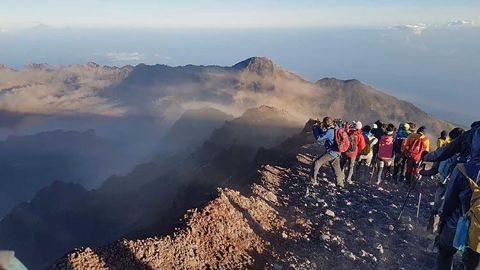 """Anuwat Kongko, a 28-year-old hiker from Thailand, was on top of Mount Rinjani when the earthquake hit.   """"I reached the summit [Mont Rinjani] at around 6am along with some friends. Then I spent some time taking pictures with my camera with my friends until 6.47am, when the 1st earthquake occurred. It's just like the mountain was shaking. Everyone crouched on the floor and after it stopped I started to run away from there.   """"After 10minutes an aftershock happened. Then, everyone was told to move out from there pretty quickly (you can see it in my video). Some of the pathway was destroyed by the earthquake.""""   Kongko said it took them 1 hour to get from the summit to the camping area, and 3 hours from the camping area to the village."""