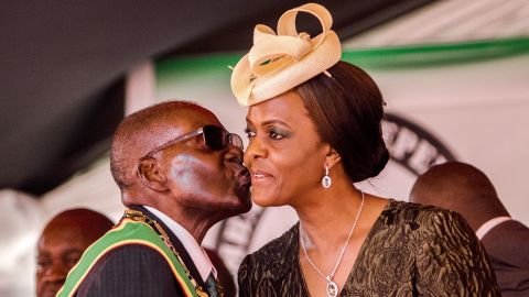 Former president Robert Mugabe kisses his wife and former first lady Grace Mugabe during during the country's 37th Independence Day celebrations at the National Sports Stadium in Harare April 18, 2017.