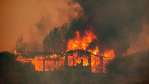 A house burns at the Mendocino Complex fire near Finley, California on July 30, 2018. Thousands of firefighters in California made some progress against several large-scale blazes that have turned close to 200,000 acres into an ashen wasteland, destroyed expensive homes, and killed eight fire personnel and civilians in the most populous US state. The worst blaze, northern California's Carr Fire, has killed six people since Thursday, including a 70-year-old woman and her two great-grandchildren aged four and five. They perished when flames swallowed their home in Redding. / AFP PHOTO / JOSH EDELSONJOSH EDELSON/AFP/Getty Images