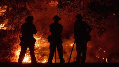 Firefighters in Upper Lake watch a back burn on July 31.