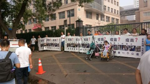 Small group of protestors hold a rare public demonstration over the vaccine scandal in front of China's Food and Drug Administration in Beijing on Monday July 30.