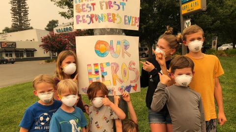 Children with their handmade signs thanking first responders fighting the Carr Fire in Redding, CA.