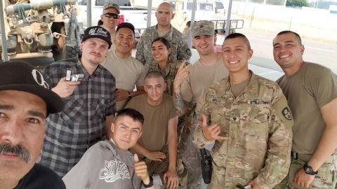 A selfie of Borjon and Buchan with members of the National Guard in Redding.