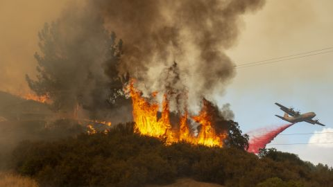 Fire retardant is dropped near a home as the Mendocino Complex Fire burns near Lakeport on Monday, July 30.