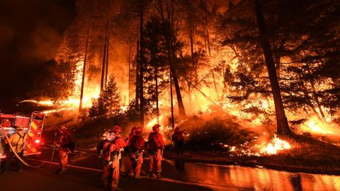 Firefighters try to control a back burn as the Carr Fire spreads toward the towns of Douglas City and Lewiston on July 31.