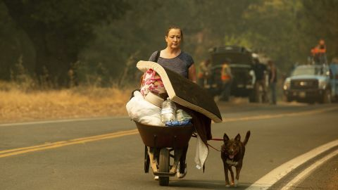 A woman leaves Lakeport as the River Fire approaches on July 31.