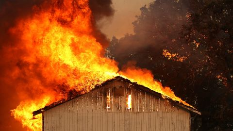 A house burns as the River Fire moves through the Lakeport area on July 31.