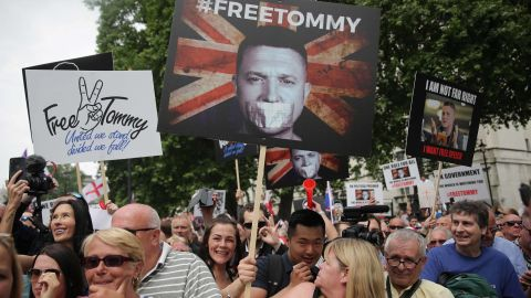 Protesters hold up placards at a gathering by supporters of far-right figure Tommy Robinson in central London on June 9, 2018.
