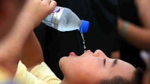 A young boy drinks icy water to get cool during a 2006 summer heatwave in Beijing.