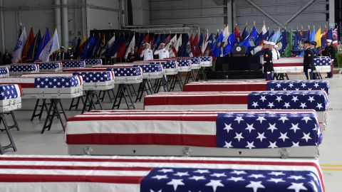 Military members carry transfer cases from a C-17 at a ceremony marking the arrival of the remains believed to be of American service members who fell in the Korean War at Joint Base Pearl Harbor-Hickam, Hawaii, Wednesday, Aug. 1, 2018. North Korea handed over the remains last week. (AP Photo/Susan Walsh)
