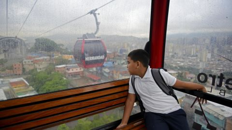 Leobardo Medina, 8, rides a gondola lift to school in Caracas, Venezuela.