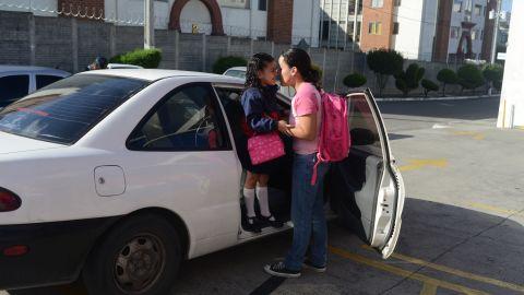 Margarita Samayoa drops off her 6-year-old daughter, Valentina Rodas, in Guatemala City, Guatemala.
