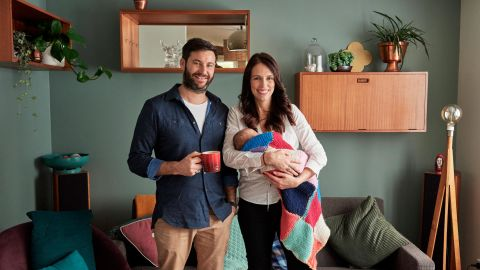 Ardern and Gayford pose for a family photo with Neve at their home in Auckland.
