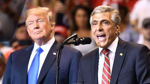 Rep. Lou Barletta stands beside President Donald Trump at a political rally in Pennsylania in August.