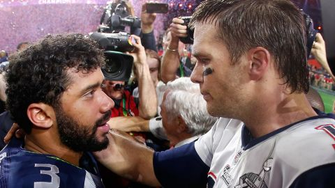Super Bowl winners Russell Wilson (left), of the Seattle Seahawks, and Tom Brady of the New England Patriots are two elite NFL quarterbacks, yet neither is in the top 10 of the league's highest paid players. Here is a list of the top 20 NFL earners, based on average salary per year. (Source: overthecap.com)