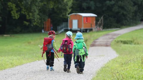 Children walk to forest kindergarten, which is held mostly outdoors, in Wessling, a municipality in Bavaria, Germany.